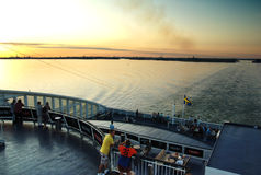 People on evening ferry. Royalty Free Stock Photography