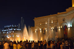 People in evening Yerevan. People watching the fountains at night at Revolution square in Yerevan, Armenia Stock Photo