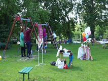 People at event. Adults and kids by equipment on a playground during a Kindergarten event on circa May 2019 in Poznan, Poland stock video footage