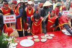 People exam to make round sticky rice cake Stock Image