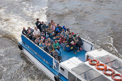 People on the excursion boat. Saint-Petersburg. Russia. SAINT - PETERSBURG, RUSSIA - MAY 30, 2017: Top view of the people in excursion boat. The boat sails under stock photography