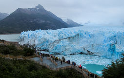 People on excursion at glacier Perito Moreno in Patagonia, Argentina. People on excursion bridge at blue ice glacier Perito Moreno in Patagonia, Argentina Stock Images