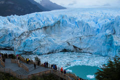 People on excursion at glacier Perito Moreno in Patagonia, Argentina. People on excursion bridge at blue ice glacier Perito Moreno in Patagonia, Argentina Royalty Free Stock Photo