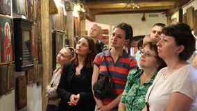 People at excursion inside Radomysl Castle, the museum of Ukrainian home icons stock video