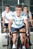 People On Exercise Bikes Stock Photo
