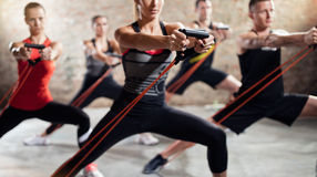 People on exercise class. Exercise class with stretching band royalty free stock photos