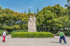 People exercising badminton marx and engels statue in fuxing par Royalty Free Stock Photos
