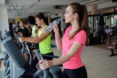 People exercising on a cardio training machine Stock Photos