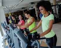 People exercising on a cardio training machines Stock Photos