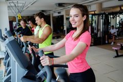 People exercising on a cardio training machines. In a gym Stock Images