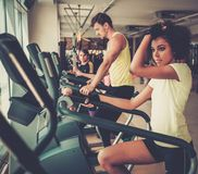 People exercising on a cardio training machines Royalty Free Stock Photos