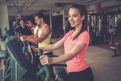 People exercising on a cardio training machines Royalty Free Stock Photography