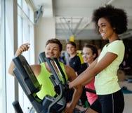 People exercising on a cardio training machines Royalty Free Stock Image