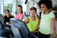 People exercising on a cardio training machines Stock Photo
