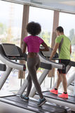 People exercising cardio on treadmill Royalty Free Stock Image