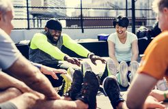 People exercising at fitness gym royalty free stock photo