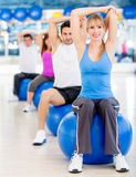 People exercising at the gym Stock Image