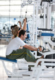 People exercising at the gym Stock Images