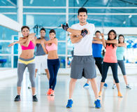 People exercising at the gym Stock Photography