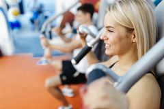 People exercising in gym royalty free stock images