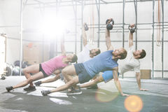 People exercising with kettlebells at crossfit gym