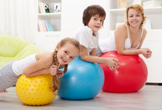 People exercising with large rubber balls Royalty Free Stock Image