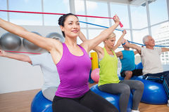 People exercising with resistance bands in gym Stock Photography
