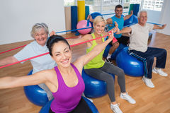 People exercising with resistance bands in gym Royalty Free Stock Images