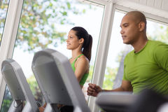 People exercising and running on treadmill in gym stock photos