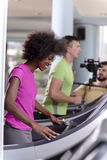 People exercisinng a cardio on treadmill in gym Royalty Free Stock Images