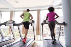 People exercisinng a cardio on treadmill in gym Stock Photography