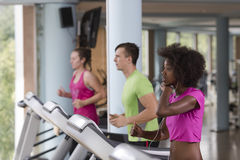 People exercisinng a cardio on treadmill in gym Stock Images