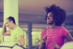 People exercisinng a cardio on treadmill Stock Images