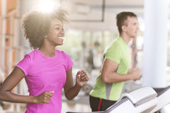 People exercisinng a cardio on treadmill Stock Photos