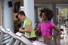 People exercisinng a cardio on treadmill Royalty Free Stock Image