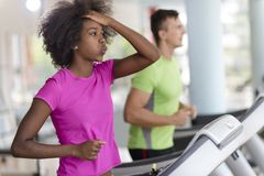 People exercisinng a cardio on treadmill Royalty Free Stock Photography