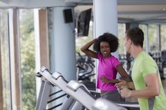 People exercisinng a cardio on treadmill Royalty Free Stock Images