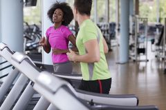 People exercisinng a cardio on treadmill Stock Image