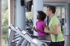 People exercisinng a cardio on treadmill Royalty Free Stock Photos