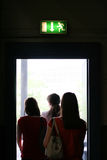 People exit the back door Stock Photo