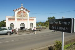 People explore the Notre dame des laves church in Sainte-Rose De La Reunion, France. Royalty Free Stock Photos