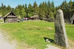 People explore reconstructed traditional Viking village in Kamroy, Norway. Royalty Free Stock Photography