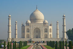 People explore Taj Mahal mausoleum at sunrise in Agra, India. Royalty Free Stock Photo