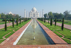 People explore Taj Mahal mausoleum at sunrise in Agra, India. Stock Images