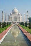 People explore Taj Mahal mausoleum at sunrise in Agra, India. Stock Photo