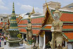 People explore Wat Phra Kaew complex in Bangkok, Thailand. Stock Images