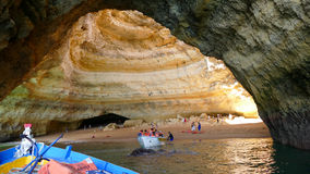 People Exploring caves on the boat - Portugal stock images