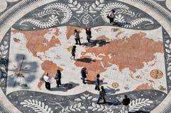 People on world map, belem, lisbon. People exploring the world map, belem, lisbon, portugal Stock Photo
