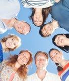 People express positivity across sky. Group of people express positivity across blue sky stock image