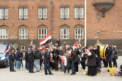 People expressing their political opiniion. Demonstration in support of Bashar al-Assad in Syria on City Hall Square on March 18, 2012 in Copenhagen, Denmark Royalty Free Stock Photos
